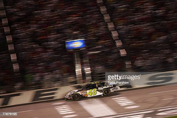 Jimmie Johnson driver of the Lowe's/Kobalt Chevrolet races during the final laps of the NASCAR Nextel Cup Series Dickies 500 at Texas Motor Speedway...