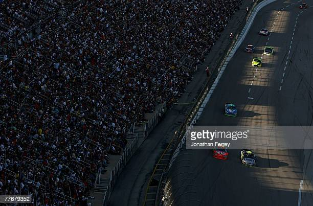 Jimmie Johnson driver of the Lowe's/Kobalt Chevrolet races next to Jeff Gordon driver of the DuPont Chevrolet during the NASCAR Nextel Cup Series...