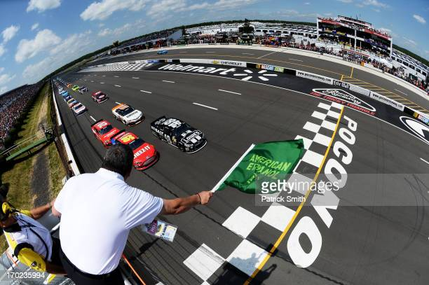 Jimmie Johnson driver of the Lowe's/Kobalt Tools Chevrolet and Carl Edwards driver of the Kellogg's/CheezIt Ford lead the field to the green flag to...