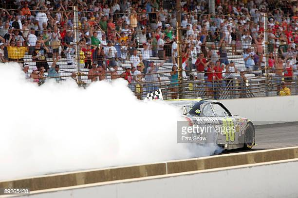 Jimmie Johnson driver of the Lowe's/KOBALT Tools Chevrolet burns out after winning the NASCAR Sprint Cup Series Allstate 400 at the Brickyard at...
