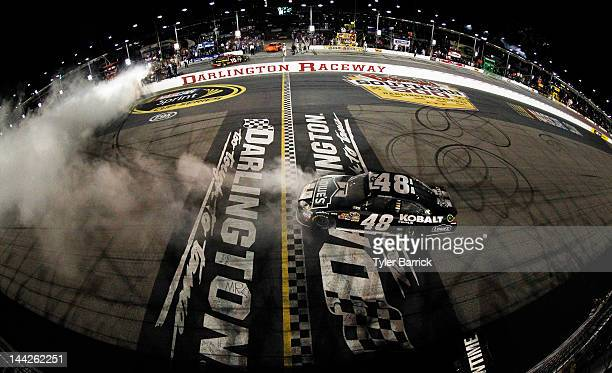 Jimmie Johnson driver of the Lowe's/Kobalt Tools Chevrolet celebrates winning the NASCAR Sprint Cup Series Bojangles' Southern 500 with a burnout at...