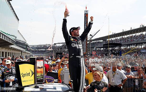 Jimmie Johnson, driver of the Lowe's/Kobalt Tools Chevrolet, celebrates in Victory Lane after winning the NASCAR Sprint Cup Series Crown Royal...