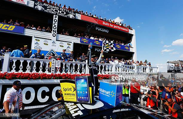 Jimmie Johnson driver of the Lowe's/Kobalt Tools Chevrolet celebrates in Victory Lane after winning during the NASCAR Sprint Cup Series Party in the...