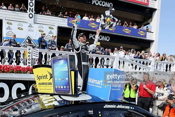 Jimmie Johnson driver of the Lowe's/Kobalt Tools Chevrolet celebrates in Victory Lane after winning the NASCAR Sprint Cup Series Party in the Poconos...