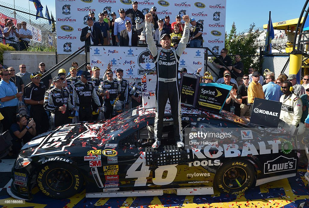 Jimmie Johnson, driver of the #48 Lowe's/Kobalt Tools Chevrolet, celebrates in victory lane after winning the NASCAR Sprint Cup Series FedEx 400 Benefiting Autism Speaks at Dover International Speedway on June 1, 2014 in Dover, Delaware.