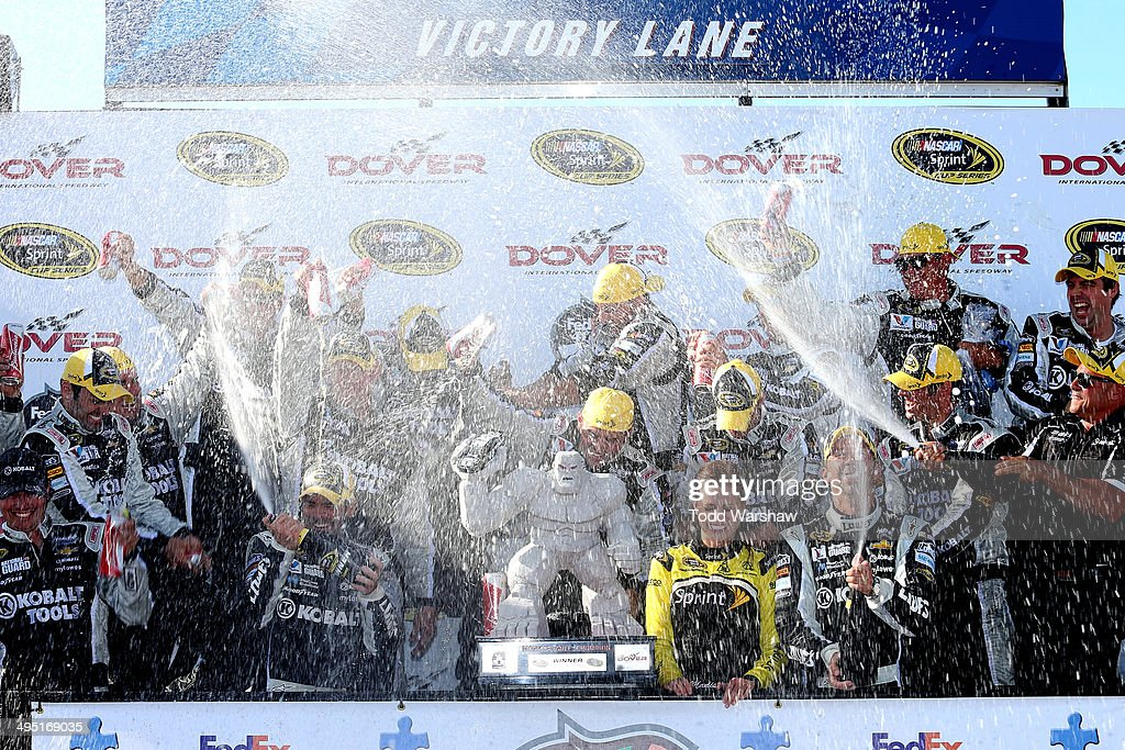 Jimmie Johnson, driver of the #48 Lowe's/Kobalt Tools Chevrolet, celebrates with his team in victory lane after winning the NASCAR Sprint Cup Series FedEx 400 Benefiting Autism Speaks at Dover International Speedway on June 1, 2014 in Dover, Delaware.