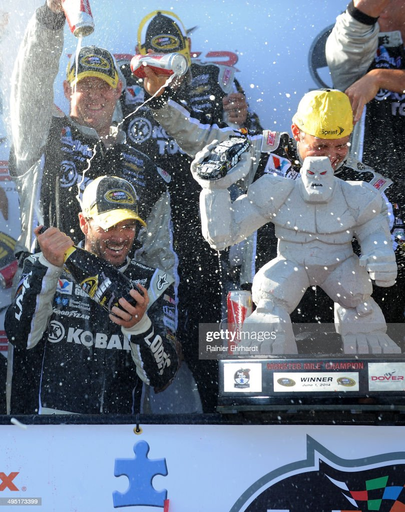 Jimmie Johnson, driver of the #48 Lowe's/Kobalt Tools Chevrolet, celebrates with champagne in Victory Lane after winning the NASCAR Sprint Cup Series FedEx 400 Benefiting Autism Speaks at Dover International Speedway on June 1, 2014 in Dover, Delaware.