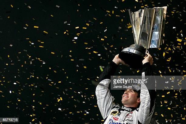 Jimmie Johnson, driver of the Lowe's/Kobalt Tools Chevrolet, celebrates winning the 2008 NASCAR Sprint Cup Series Championship after finishing 15th...