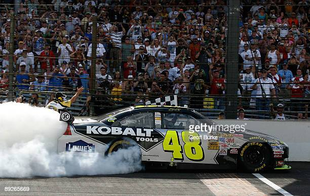 Jimmie Johnson driver of the Lowe's/KOBALT Tools Chevrolet celebrates winning the NASCAR Sprint Cup Series Allstate 400 at the Brickyard at...