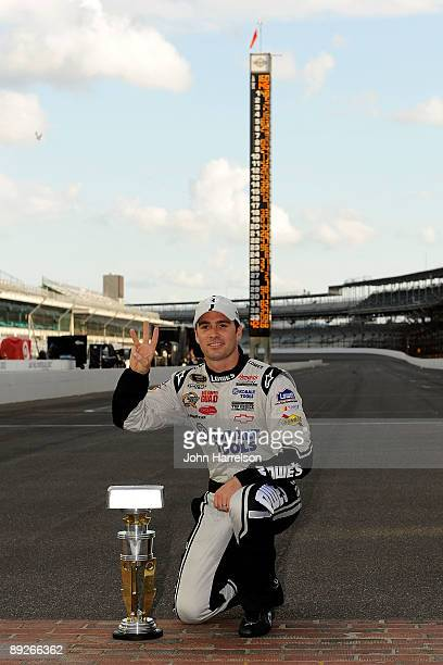 Jimmie Johnson driver of the Lowe's/KOBALT Tools Chevrolet celebrates after winning the NASCAR Sprint Cup Series Allstate 400 at the Brickyard at...