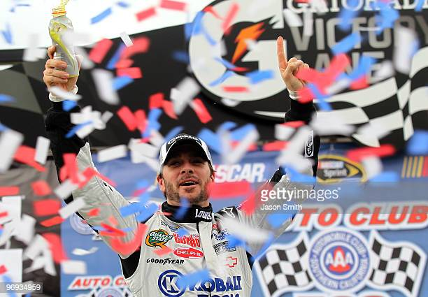 Jimmie Johnson driver of the Lowe's/Kobalt Tools Chevrolet celebrates in victory lane after winning the NASCAR Sprint Cup Series Auto Club 500 at...