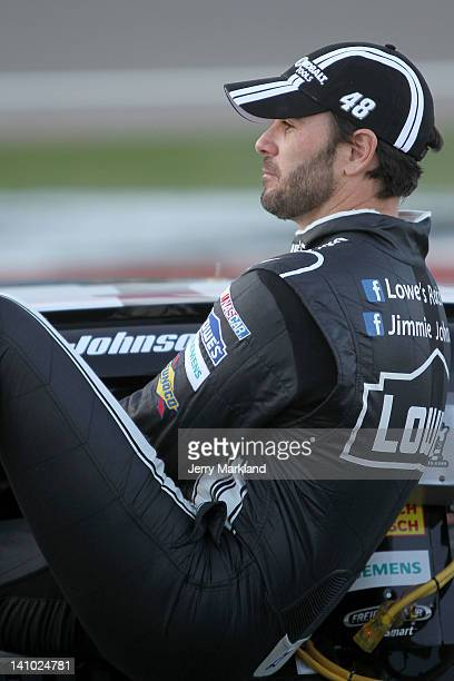 Jimmie Johnson driver of the Lowe's/Kobalt Tools Chevrolet climbs into his car during qualifying for the NASCAR Sprint Cup Series Kobalt Tools 400 at...