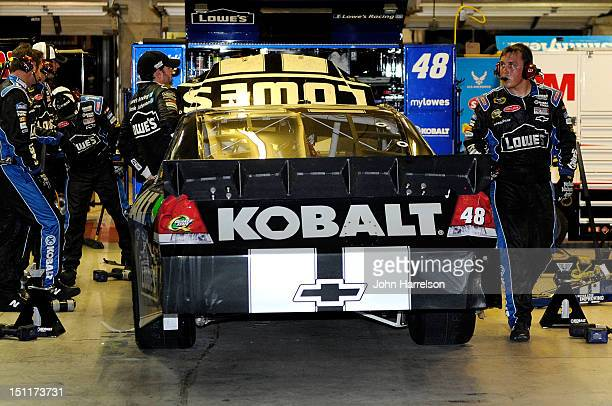 Jimmie Johnson driver of the Lowe's/Kobalt Tools Chevrolet climbs out of his car after he was knocked out of the race due to an on track crash during...