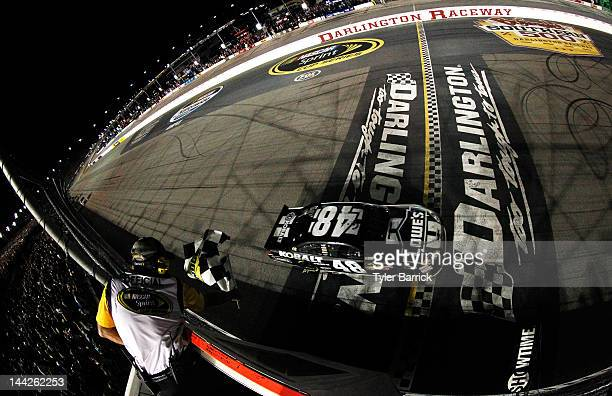 Jimmie Johnson driver of the Lowe's/Kobalt Tools Chevrolet crosses the finishline to win the NASCAR Sprint Cup Series Bojangles' Southern 500 at...