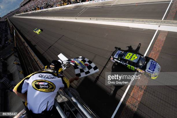 Jimmie Johnson driver of the Lowe's/KOBALT Tools Chevrolet crosses the finish line to win the NASCAR Sprint Cup Series Allstate 400 at the Brickyard...