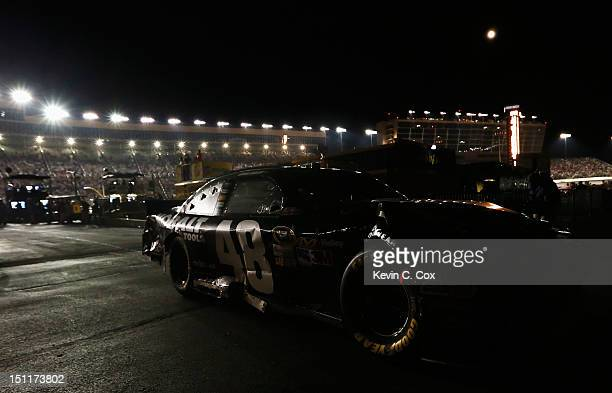 Jimmie Johnson driver of the Lowe's/Kobalt Tools Chevrolet drives his car into the garage after he was knocked out of the race during the NASCAR...