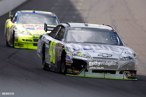 Jimmie Johnson driver of the Lowe's/KOBALT Tools Chevrolet drives in front of Mark Martin driver of the CARQUEST/Kellogg's Chevrolet before Johnson...