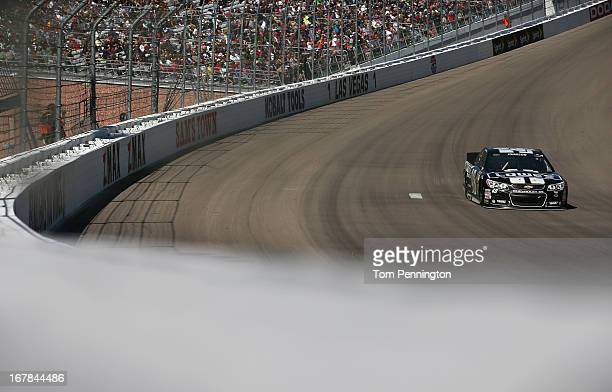 Jimmie Johnson driver of the Lowe's/Kobalt Tools Chevrolet drives during the NASCAR Sprint Cup Series Kobalt Tools 400 at Las Vegas Motor Speedway on...
