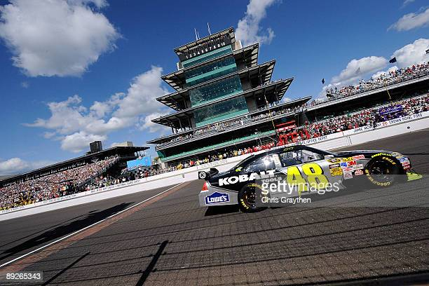 Jimmie Johnson driver of the Lowe's/KOBALT Tools Chevrolet drives before winning the NASCAR Sprint Cup Series Allstate 400 at the Brickyard at...