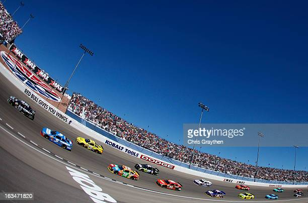 Jimmie Johnson driver of the Lowe's/Kobalt Tools Chevrolet leads a group of cars during the NASCAR Sprint Cup Series Kobalt Tools 400 at Las Vegas...