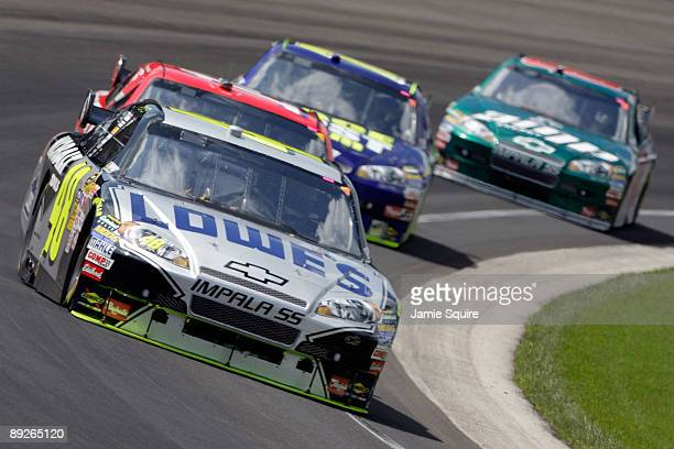 Jimmie Johnson driver of the Lowe's/KOBALT Tools Chevrolet leads a group of cars during the NASCAR Sprint Cup Series Allstate 400 at the Brickyard at...