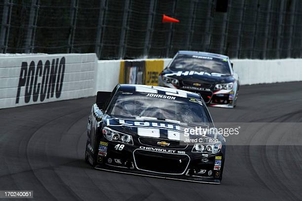 Jimmie Johnson driver of the Lowe's/Kobalt Tools Chevrolet leads Ryan Newman driver of the HAAS Automation Chevrolet during the NASCAR Sprint Cup...