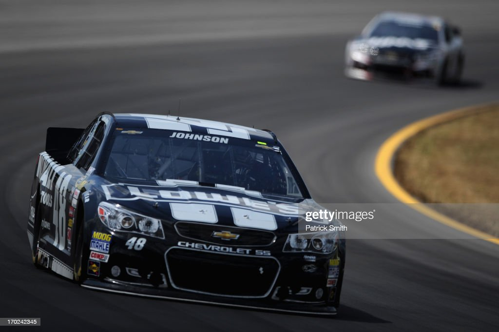 Jimmie Johnson, driver of the #48 Lowe's/Kobalt Tools Chevrolet, leads Ryan Newman, driver of the #39 HAAS Automation Chevrolet, during the NASCAR Sprint Cup Series Party in the Poconos 400 at Pocono Raceway on June 9, 2013 in Long Pond, Pennsylvania.