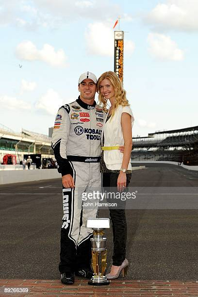Jimmie Johnson driver of the Lowe's/KOBALT Tools Chevrolet poses with wife Chandra Johnson after winning the NASCAR Sprint Cup Series Allstate 400 at...