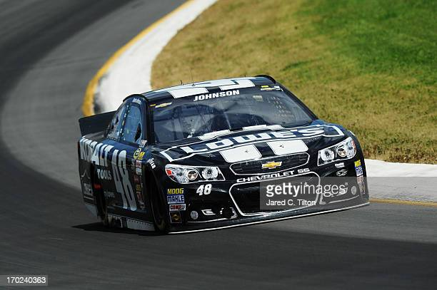Jimmie Johnson driver of the Lowe's/Kobalt Tools Chevrolet races during the NASCAR Sprint Cup Series Party in the Poconos 400 at Pocono Raceway on...