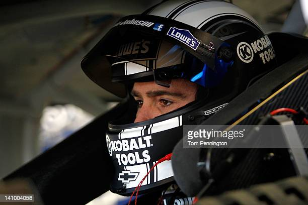 Jimmie Johnson driver of the Lowe's/Kobalt Tools Chevrolet sits in his car in the garage during practice for the NASCAR Sprint Cup Series Kobalt...