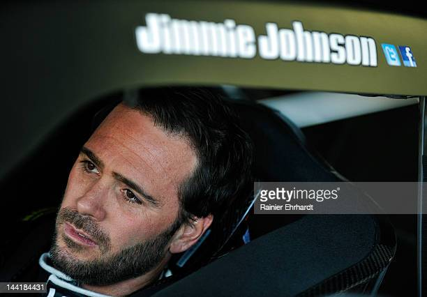 Jimmie Johnson driver of the Lowe's/Kobalt Tools Chevrolet sits in his car in the garage area during practice for the NASCAR Sprint Cup Series...