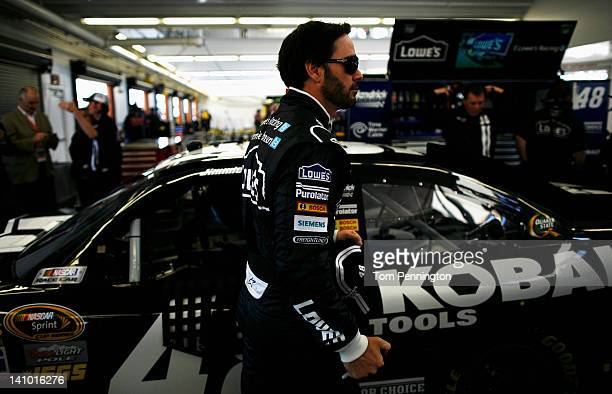 Jimmie Johnson driver of the Lowe's/Kobalt Tools Chevrolet walks in the garage during practice for the NASCAR Sprint Cup Series Kobalt Tools 400 at...