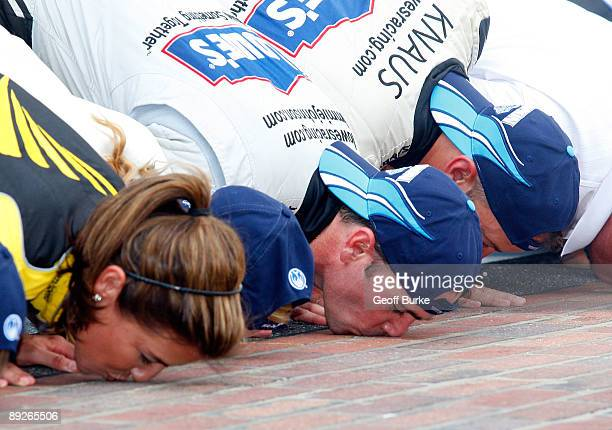 Jimmie Johnson driver of the Lowe's/KOBALT Tools Chevroletcelebrates by kissing the bricks after Johnson wins the NASCAR Sprint Cup Series Allstate...