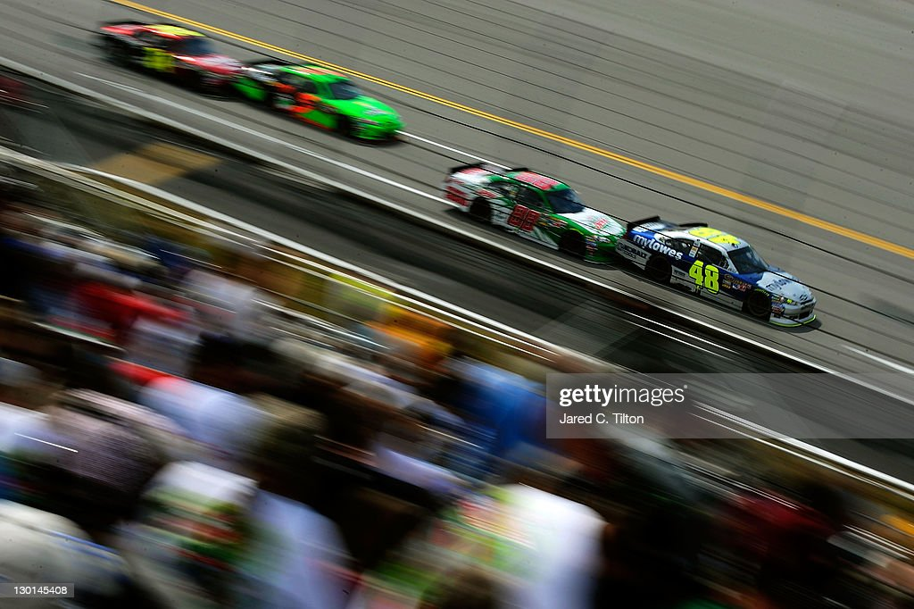 Jimmie Johnson, driver of the #48 MyLowe's Chevrolet, leads a line of cars during the NASCAR Sprint Cup Series Good Sam Club 500 at Talladega Superspeedway on October 23, 2011 in Talladega, Alabama.