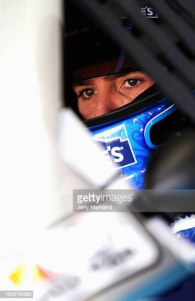 Jimmie Johnson driver of the MyLowe's Chevrolet sits in his car in the garage area during practice for the NASCAR Sprint Cup Series Bank of America...