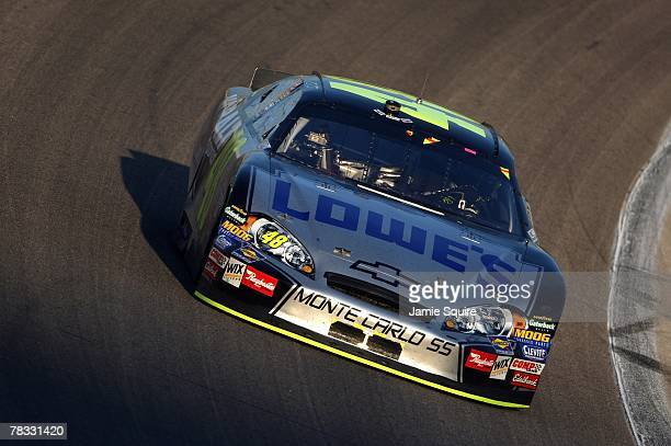 Jimmie Johnson drives his Lowe's Chevrolet during the NASCAR Nextel Cup Series Dickies 500 at Texas Motor Speedway on November 4 2007 in Fort Worth...
