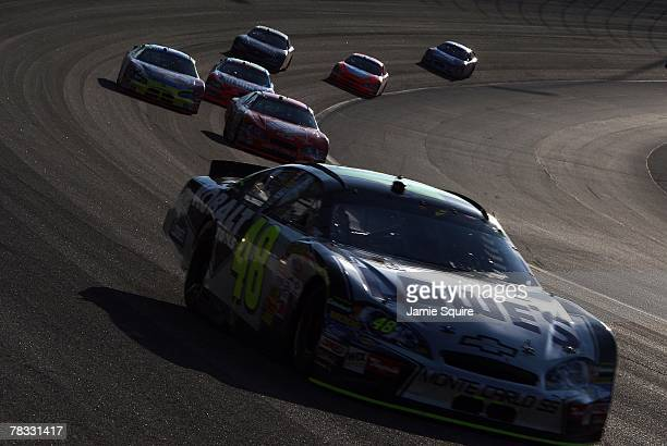 Jimmie Johnson drives his Lowe's Chevrolet in a turn during the NASCAR Nextel Cup Series Dickies 500 at Texas Motor Speedway on November 4 2007 in...