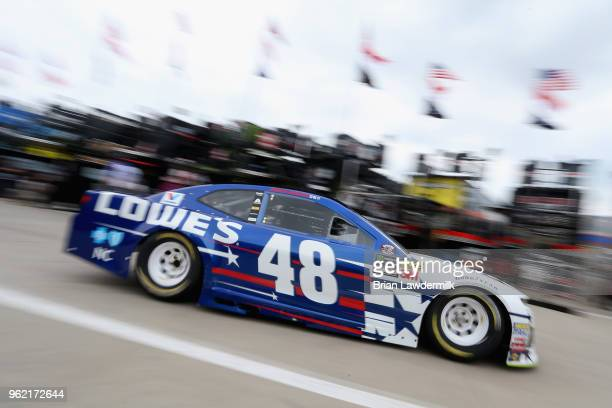 Jimmie Johnson drives the Lowe's Patriotic Chevrolet through the garage area during practice for the Monster Energy NASCAR Cup Series CocaCola 600 at...