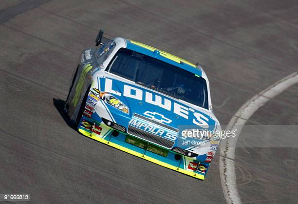 Jimmie Johnson drives the Lowes's Chevrolet during practice for the NASCAR Sprint Cup Series Pepsi 500 at Auto Club Speedway on October 9 2009 in...