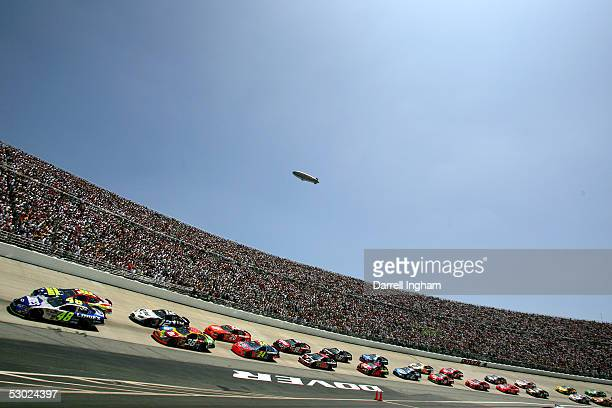 Jimmie Johnson driving the Hendrick Motorsports Lowe's Chevrolet leads the field at the start of the NASCAR Nextel Cup MBNA RacePoints 400 on June 5...