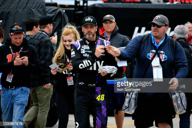 Jimmie Johnson Hendrick Motorsports Chevrolet Camaro Ally signs autographs during practice for the 62nd annual Daytona 500 on February 14 2020 at...