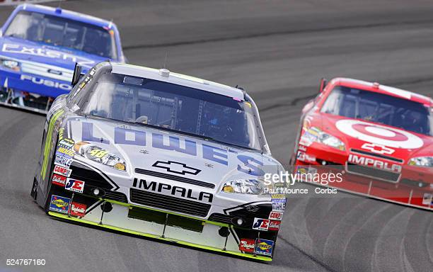 Jimmie Johnson in the Lowe's Chevy leads Juan Pablo Montoya in the Target Chevy and Kevin Conway in the Extenze Ford during the Auto Club 500