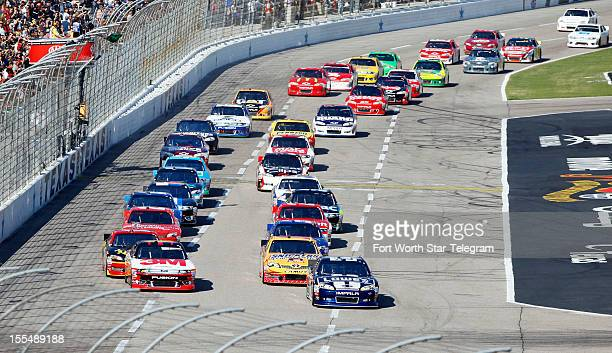 Jimmie Johnson in the No 48 car leads the pack at the start during the NASCAR Sprint Cup AAA Texas 500 at Texas Motor Speedway in Fort Worth Texas on...