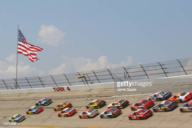 Jimmie Johnson Jeff Gordon and Rusty Wallace lead the field through the 4th turn for the start of the NASCAR Winston Cup EA Sports 500 at Talladega...