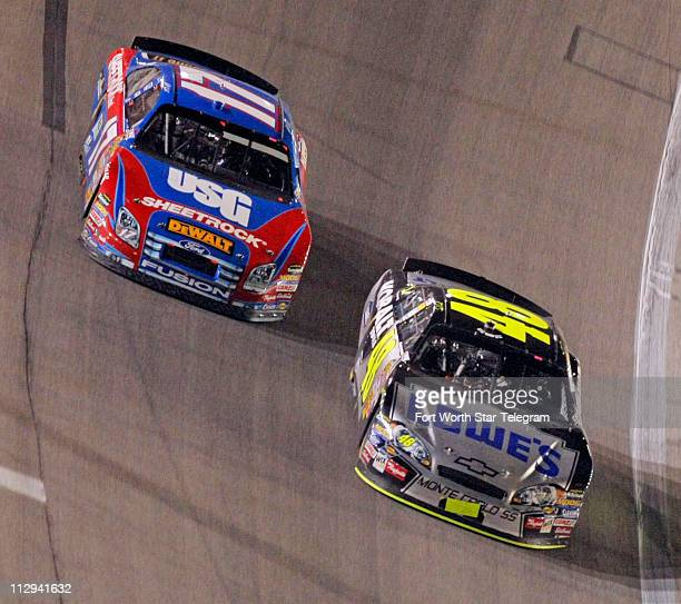 Jimmie Johnson passes Matt Kenseth for the lead on lap 331 during the NASCAR Nextel Cup series Dickies 500 race at Texas Motor Speedway in Fort Worth...