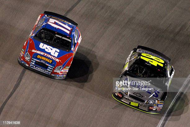 Jimmie Johnson passes race leader Matt Kenseth to take the win in the NASCAR Nextel Cup series Dickies 500 race at Texas Motor Speedway in Fort Worth...