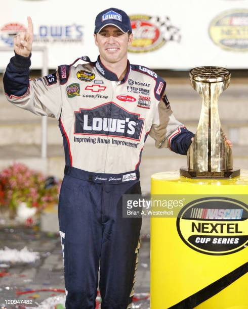 Jimmie Johnson poses with the trophy in Victory Lane after winning his second consecutive Coca-Cola 600 at Lowe's Motor Speedway, May 30, 2004.