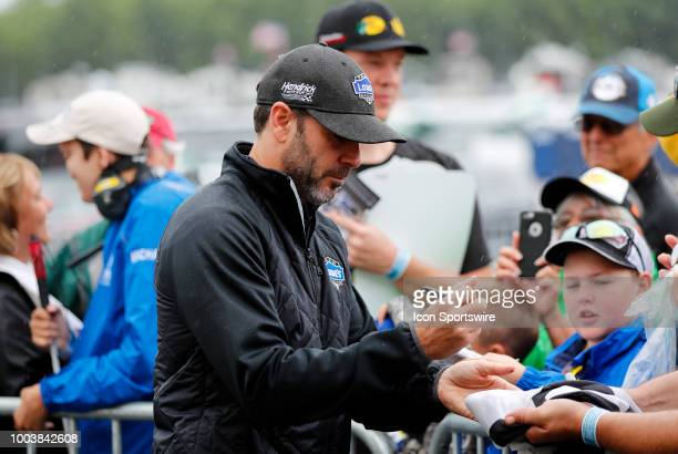 Jimmie Johnson signs autographs before the Foxwoods Resort Casino 301 on July 22 at New Hampshire Motor Speedway in Loudon New Hampshire