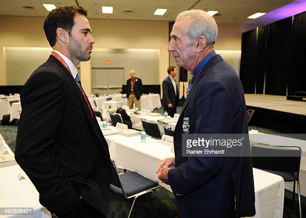 Jimmie Johnson speaks with Ned Jarrett before the NASCAR Hall of Fame Class of 2015 voting at Charlotte Convention Center on May 21 2014 in Charlotte...