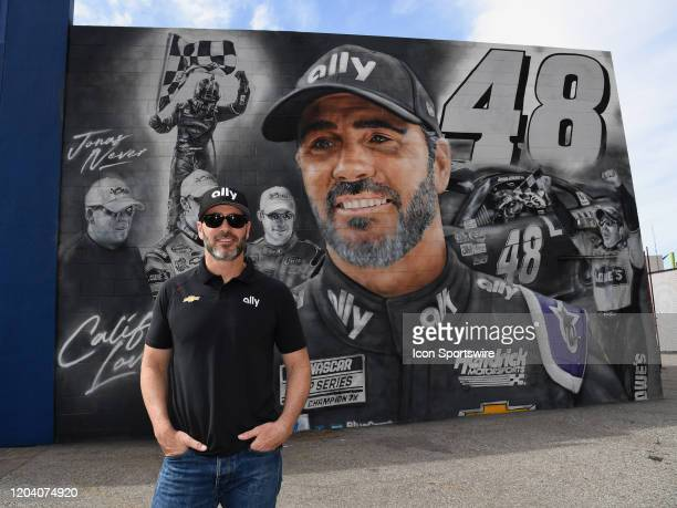 Jimmie Johnson stands in front of a mural painted in his honor in the APEX area outside the Auto Club Speedway on February 28 2020 at the Auto Club...
